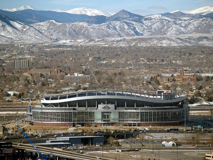 Invesco Field in Denver beneath the Rocky Mountains in Colorado, USA