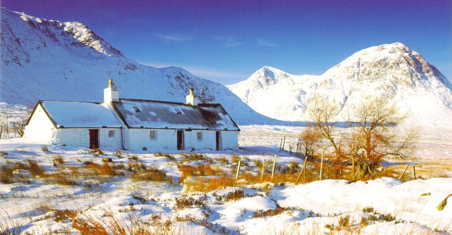 Black Rock Cottage and Buchaille Etive Mor in Glencoe snow covered in winter