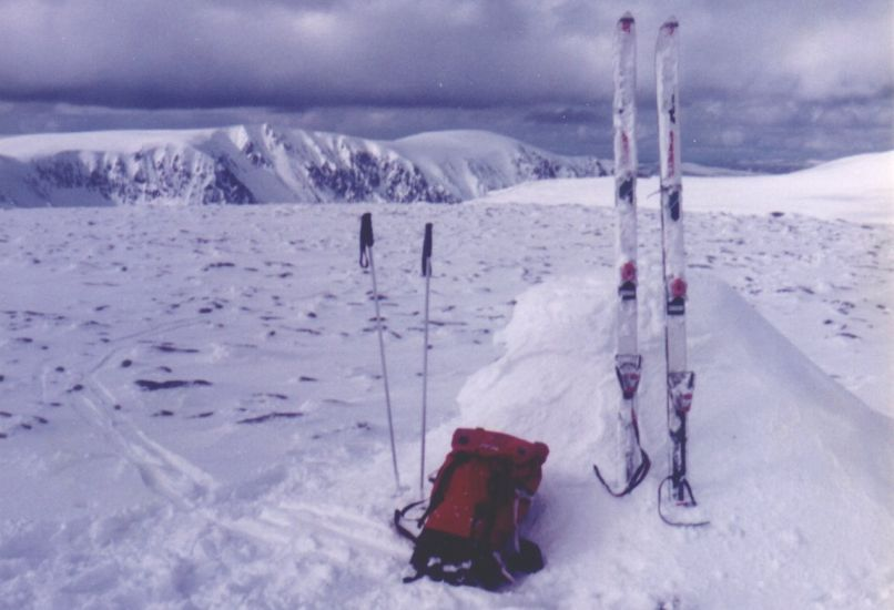 Snowbound summit cairn of Monadh Mor on the Cairngorm Plateau