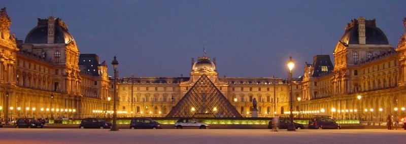 The Louvre Museum ( Musée du Louvre ) illuminated at night