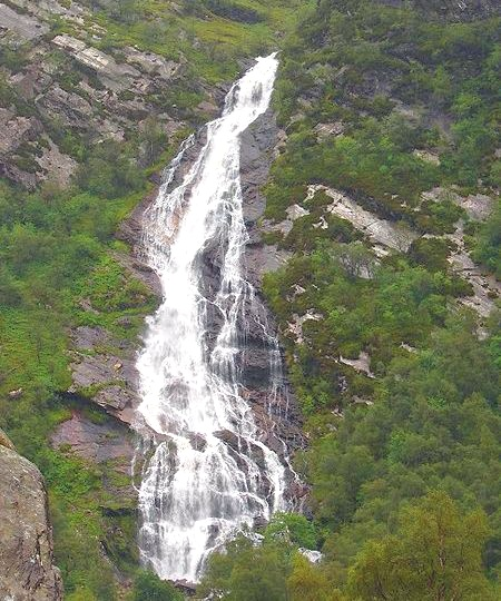 Steall waterfall in Glen Nevis beneath An Gearanach in the Mamores above Glen Nevis